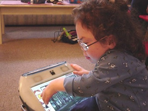 child with AAC technology