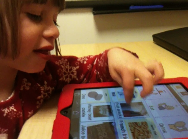 Girl with iPad, photo courtesy of the Center for Communication Enhancement, Children's Hospital Boston..