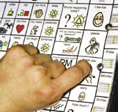 person using a communication board